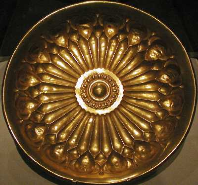 golden bowl thesis The kingdom of mapungubwe a male, was buried with his hand grasping the golden scepter depicting a bowl, scepter and rhino.